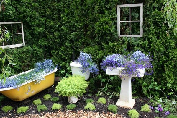 Pedestal Sink Turned Into Decorative Planters